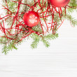 Two red Xmas balls and tree branch on blank paper — Stock Photo #78834090