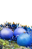 Blue and violet Xmas balls on green spruce branch — Stock Photo