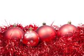 Four red Christmas balls and tinsel isolated — Stock Photo
