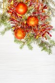 Three orange Xmas balls and twig on blank paper — Stock Photo