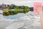 Hand deletes ice floe in winter river by cloth — Stock Photo