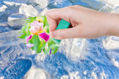 Hand deletes ice and snow by rubber eraser — Stock Photo