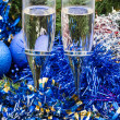 Two glasses with blue Xmas decorations and tree 2 — Stock Photo #79612522