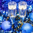 Sparkling wine glasses in blue Xmas baubles — Stock Photo #79612594