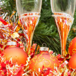 Two glasses with gold Xmas decorations and tree 2 — Stock Photo #79612552