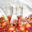 Glasses of champagne with gold Xmas decorations — Stock Photo #79612572