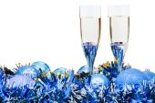 Two glasses of champagne and blue Xmas baubles — Stock Photo