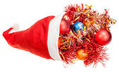 Red santa hat with xmas balls and decorations — Stock Photo