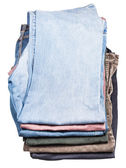 Top view of stack of various jeans and corduroys — Stock Photo