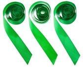 Set of green satin decorative ribbons isolated — Stock Photo
