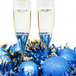 Two glasses of wine at blue Christmas decorations — Stock Photo #82432926