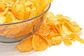 Tasty potato chips on white — Stock Photo