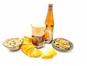 Dark beer, chips, crackers and pistachios — Stock Photo