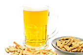 Crisps and mug of beer closeup — Stock Photo