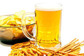 Tasty pretzels, breadsticks, chips and beer — Stock Photo