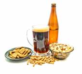 Different snacks and beer in glass — Stock Photo