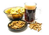 Snacks and dark beer closeup — Stock Photo