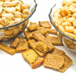 Two plates with different nuts and crackers — Stock Photo #63590499