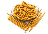 Salted pretzels and breadsticks on white  — Stock Photo