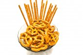 Some tasty pretzels and breadsticks on a plate — Stock Photo