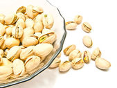 Glass plate with tasty roasted pistachios — Stock Photo