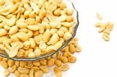 Dish with tasty roasted peanuts — Stock Photo