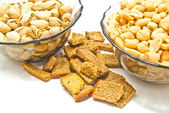 Two plates with different nuts and crackers — Stock Photo