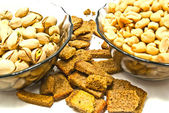 Two dish with different nuts and crackers — Stock Photo