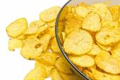 Glass plate with ruffles potato chips — Stock Photo