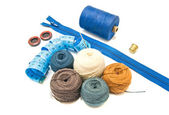 Blue meter and balls of yarn — Stock Photo