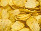 Corrugated salty potato chips — Stock Photo