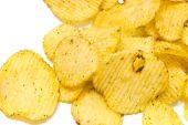 Corrugated potato chips on white — Stock Photo