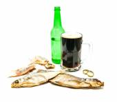 Salty fishes and glass of dark beer — Stock Photo