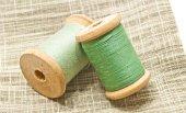 Spools of green thread — Stock Photo