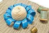 Yarn, thimble and spools of thread — Stock Photo
