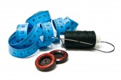 Spool of black thread, buttons and meter — Стоковое фото