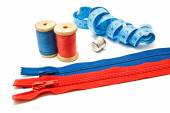 Two zipper, meter, thimble and spools of thread — Stock Photo