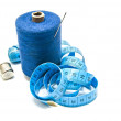 Spool of blue thread with needle, meter and thimble — Stock Photo #66014459