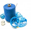 Spool of thread with needle, meter and thimble — Stock Photo #66014467