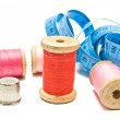 Meter, thimble and spools of thread on white — Stock Photo #66014567