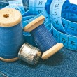 Meter, thimble and spools of thread — Stock Photo #66014625