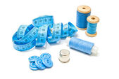 Spools of blue thread, buttons and meter — Stock Photo