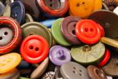 Texture of different colored clothing buttons — Stock Photo