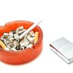Silver lighter and single cigarette — Stock Photo #66895371