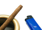 Cigarillo in ashtray and blue plastic lighter — Stock Photo