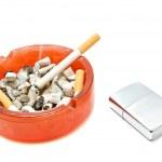 Single cigarette in ashtray and silver lighter — Stock Photo #68756799