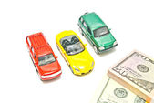 Three different cars and dollar notes — Stock Photo