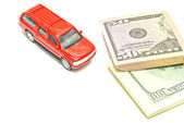 Single red car and dollar notes — Stock Photo
