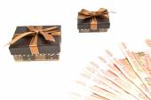 Two brown gift boxes and banknotes — Stock Photo