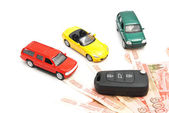 Different cars, keys and Russian banknotes — Stock Photo